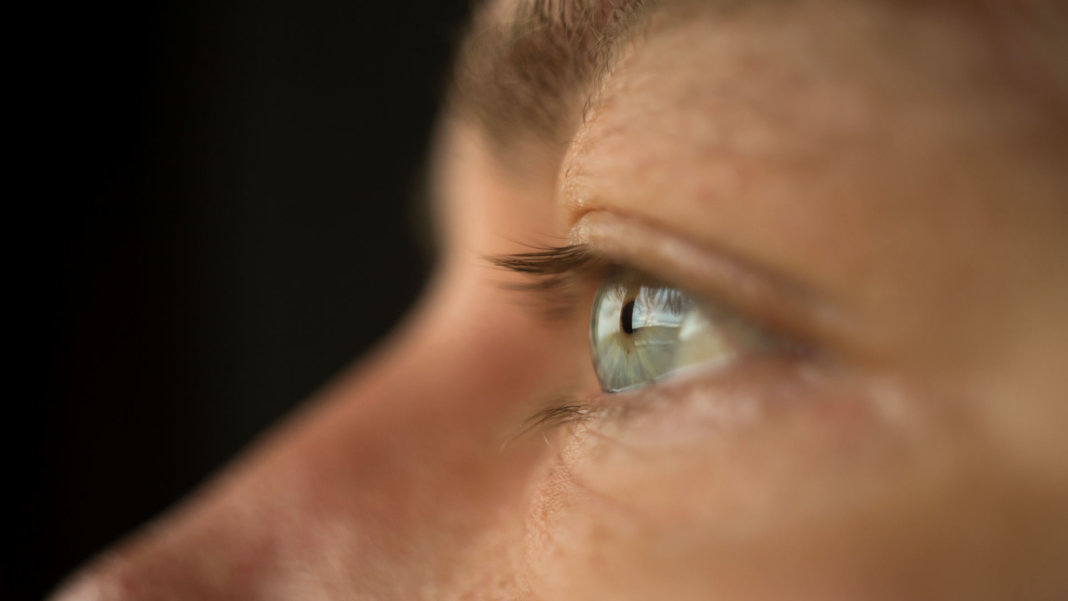 CRISPR Close up of a man's blue eye