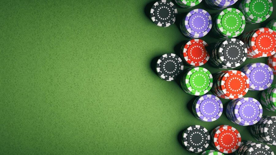 Casino poker chips on green felt background artificial intelligence