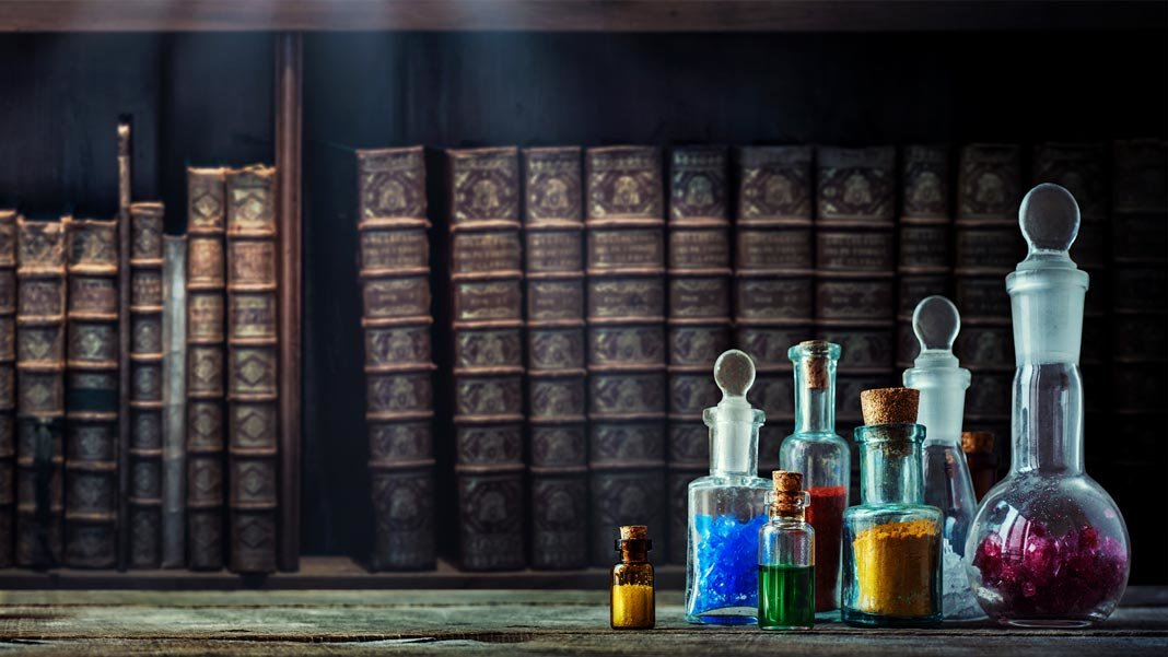 Longevity vintage medications in small bottles on wood desk and old book background