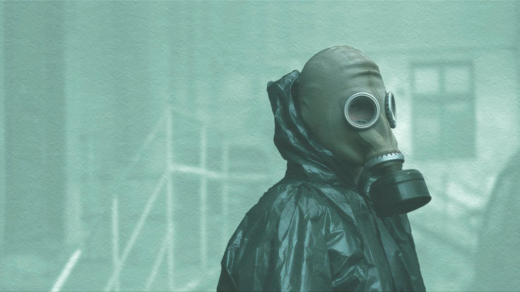 scientist with protective mask and clothing chernobyl radiation environment