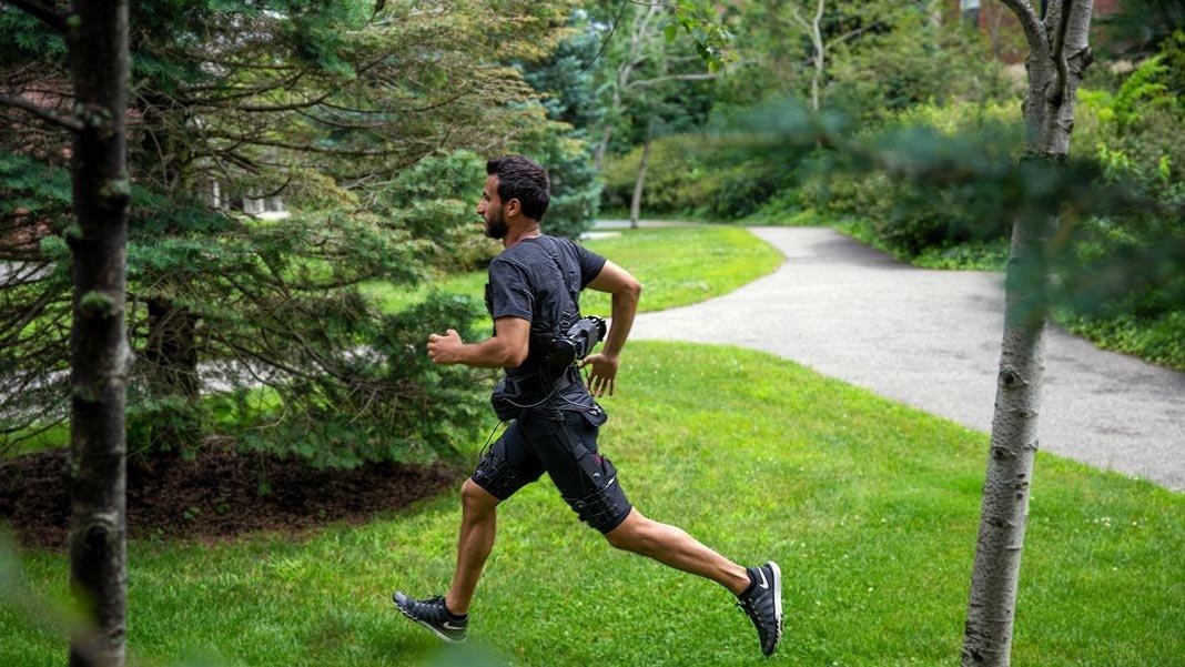 walking uphill man wearing light weight exosuit robotics