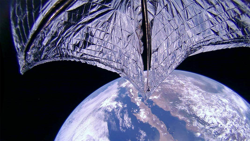LIghtsail 2 with sail and earth as background in space