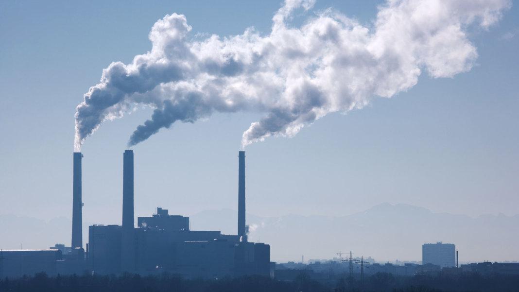 silhouette of power plant smoke stacks future of energy