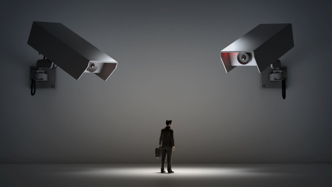 man and surveillance cameras privacy issue concept bitcoin