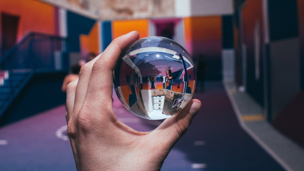future hand holding crystal ball