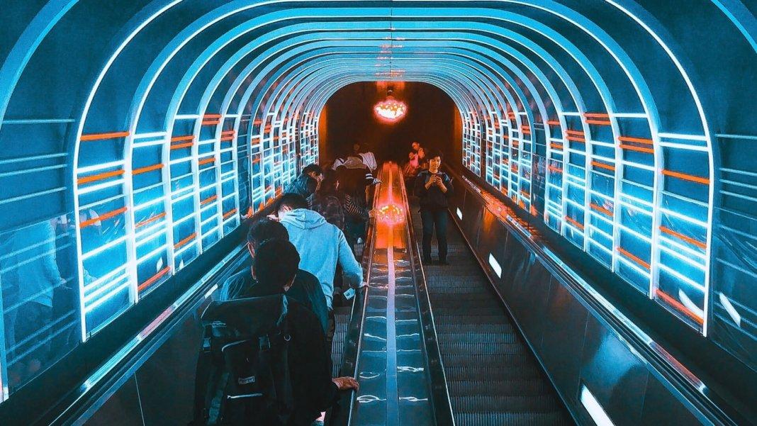 blue white red neon escalator people