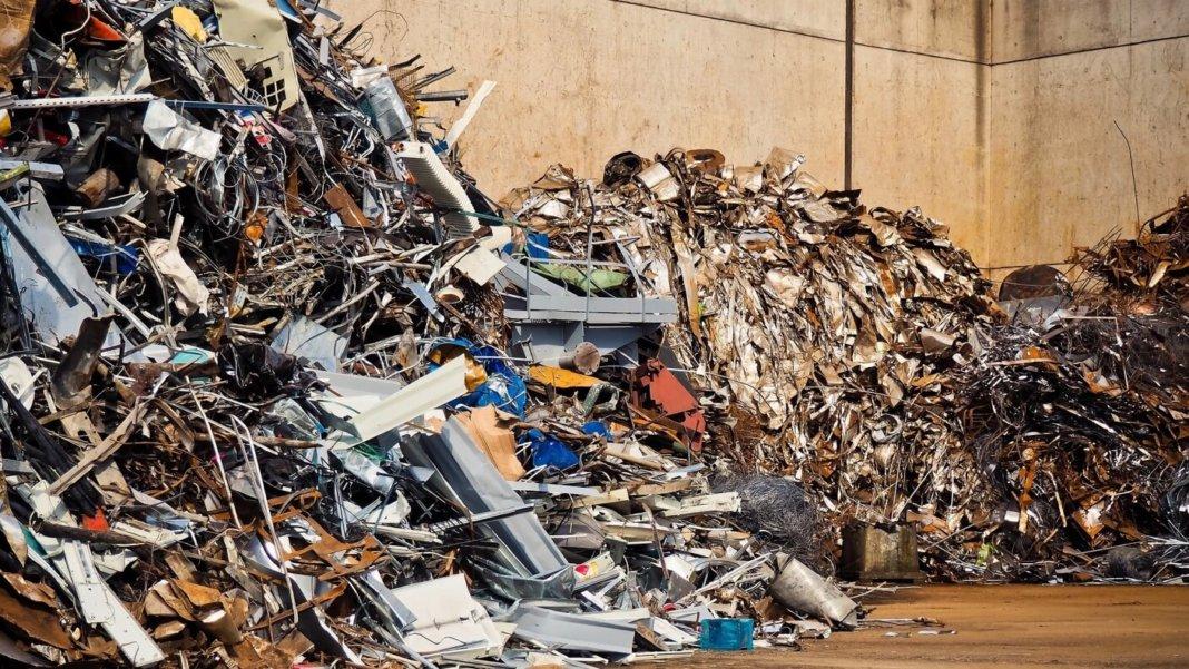 scarcity abundance metal piled scrapyard