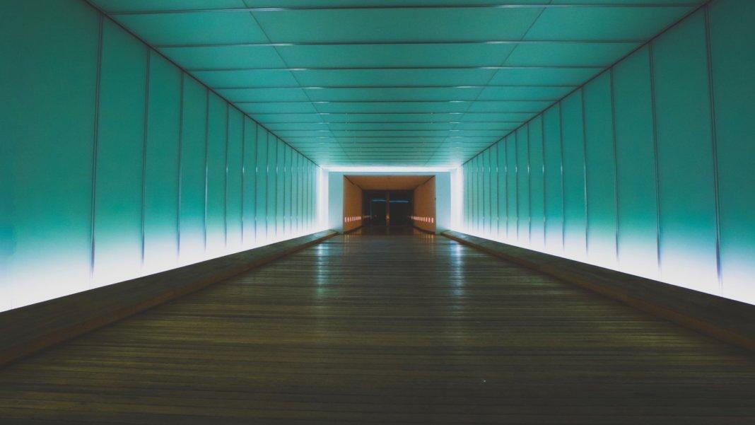 tech stories green white hallway vanishing point