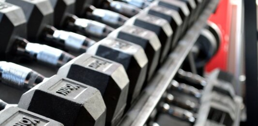 weight rack in gym fitness gene therapy muscle