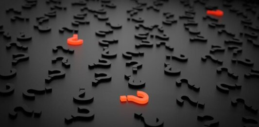 AI ethics black background with question marks