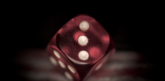 deepmind ai red dice black background probability
