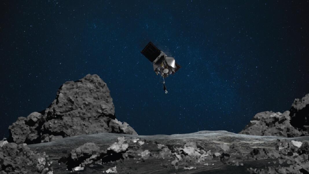 OSIRIS-REx spacecraft near asteroid in space NASA