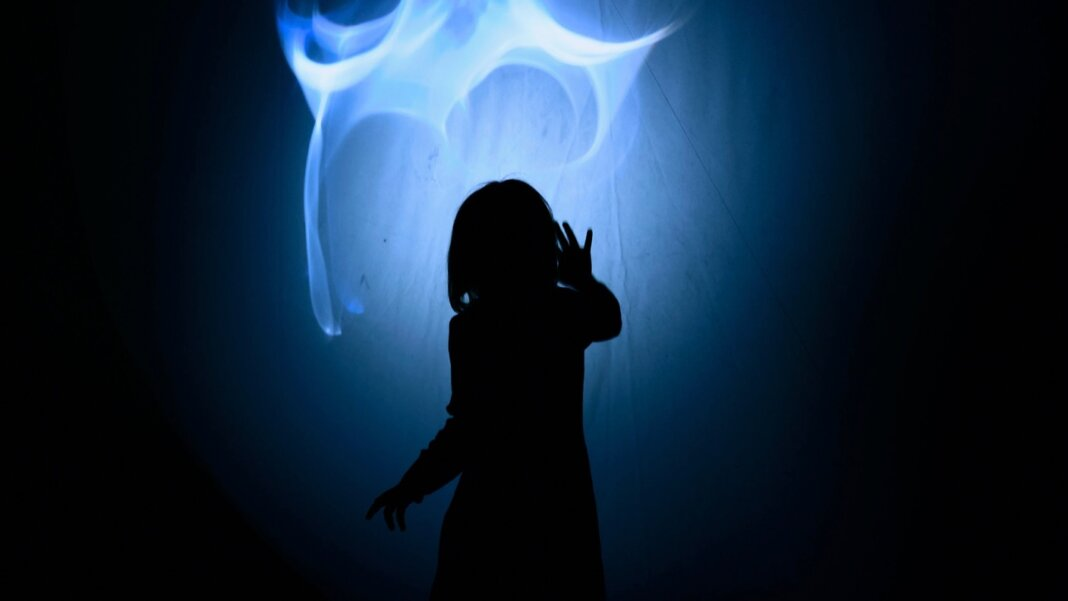 tech stories blue glowing light person sillhouette dark background