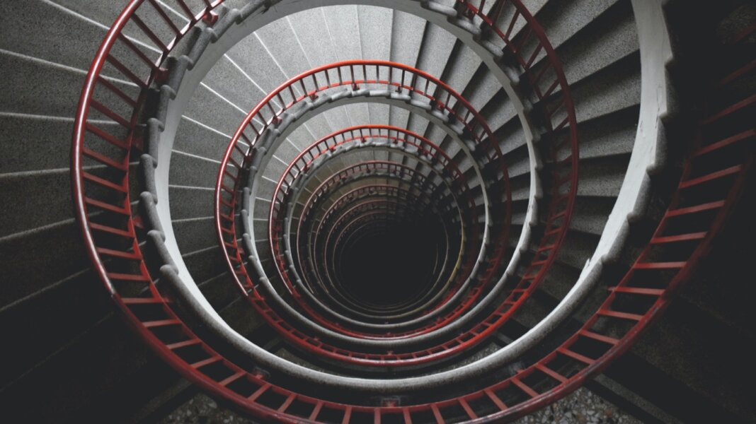 tech stories spiral stairs red bannister