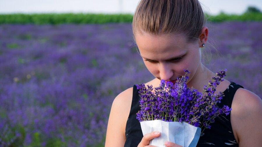 girl smelling lavender nose