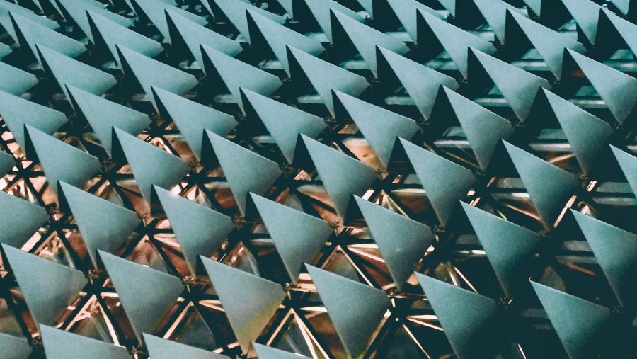 tech stories architecture repeating blue triangles
