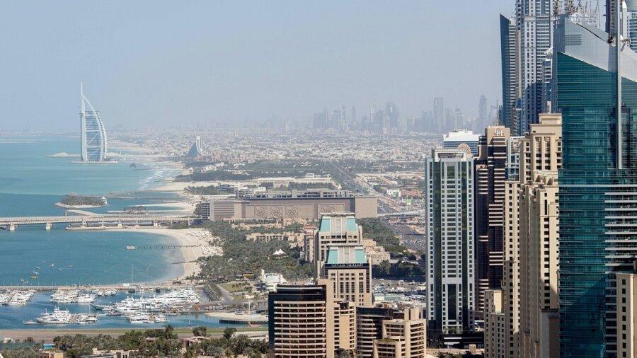 cloud seeding geoengineering Dubai UAE skyline