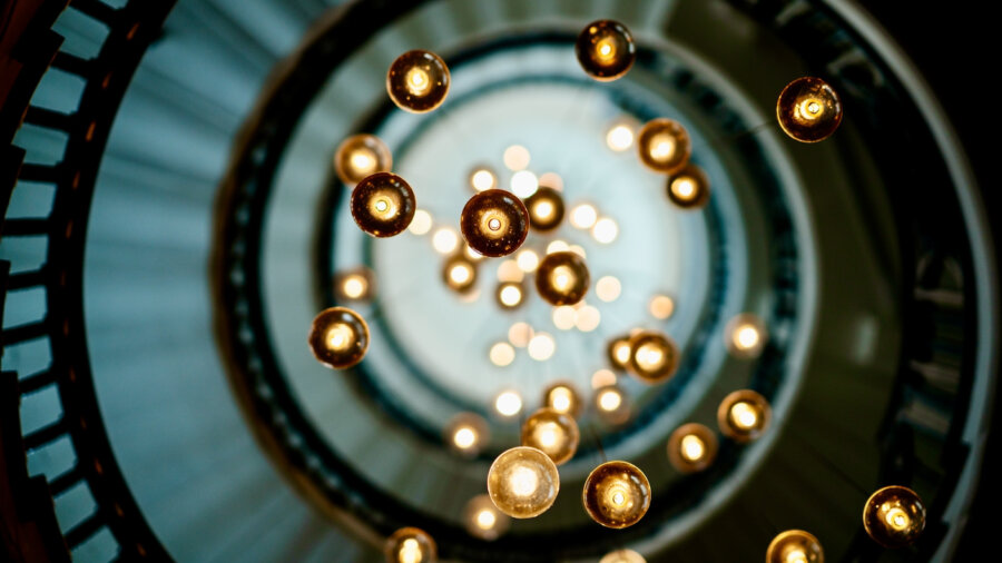 tech stories circle swarm light bulbs
