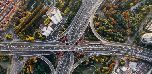 traffic on highways from above electric vehicles charging future